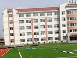 丹东市凤城东汤镇中心学校体育场地改造人造草坪铺装施工案列