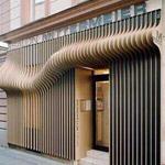 商业街门头木纹波浪铝单板厂家