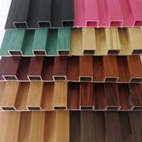 山东电视背景墙 环保木塑吊顶材料 木饰面板装修