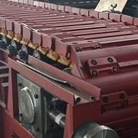 GBZ1600链板给料机托轮及槽板的改进
